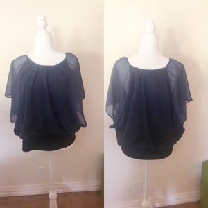 Blue blouse with black tank lining.